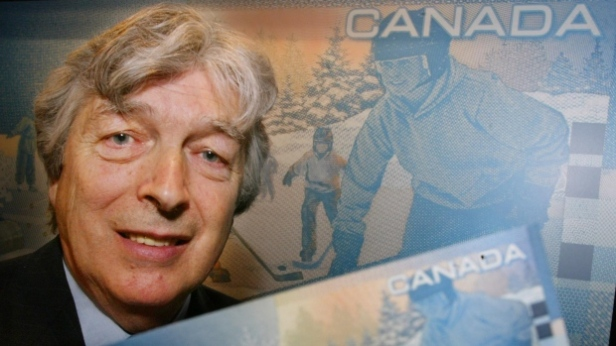 author-roch-carrier-poses-with-a-new-canadian-five-dollar-bill-during-an-unveiling-ceremony-in-montr